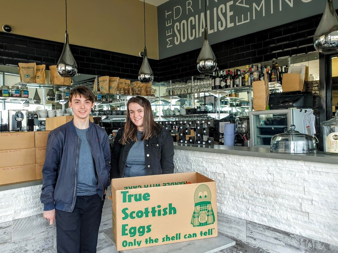 The Cove Resturant hands over food donations for Belville Community Garden